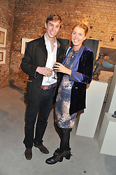 ALEC MILLS and DAISY FELLOWES at a private view of various works of art at the Art Cellar, 41a Farringdon Street, London on 4th October 2012.