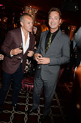 Left to right, GRAHAM NORTON and JULIAN CLARY at a party to celebrate the publication of 'Passion for Life' by Joan Collins held at No41 The Westbury Hotel, Mayfair, London on21st October 2013.