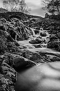 A small river in the Lake District, England. Image taken with an ND110 filter with a 60 second exposure.<br />