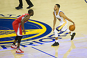 Golden State Warriors guard Stephen Curry (30) dribbles the ball down the court during the first half of the NBA preseason game against the Los Angeles Clippers at Oracle Arena in Oakland, Calif., on October 4, 2016. (Stan Olszewski/Special to S.F. Examiner)