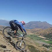 Reon Boe from Queenstown in action during the New Zealand South Island Downhill Cup Mountain Bike series held on The Remarkables face with a stunning backdrop of the Wakatipu Basin. 150 riders took part in the two day event. Queenstown, Otago, New Zealand. 9th January 2012. Photo Tim Clayton