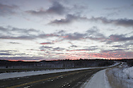 An early winter sunrise creates a pink alpenglow in the sky near the Tetlin National Wildlife Refuge on the Alaska Highway in interior Alaska. Morning.