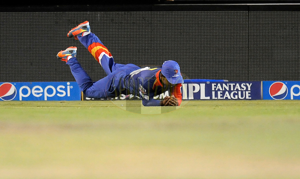 Kedar Jadhav of the Delhi Daredevils takes a catch to get the wicket of Sanju Samson of the Rajatshan Royals during match 41 of the Pepsi Indian Premier League Season 2014 between the Rajasthan Royals and the Delhi Daredevils held at the Sardar Patel Stadium, Ahmedabad, India on the 15th May  2014<br /> <br /> Photo by Pal Pillai / IPL / SPORTZPICS      <br /> <br /> <br /> <br /> Image use subject to terms and conditions which can be found here:  http://sportzpics.photoshelter.com/gallery/Pepsi-IPL-Image-terms-and-conditions/G00004VW1IVJ.gB0/C0000TScjhBM6ikg