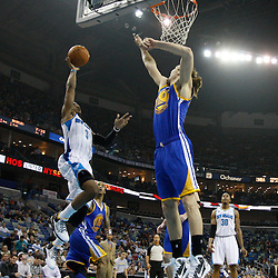 January 5, 2011; New Orleans, LA, USA; New Orleans Hornets point guard Chris Paul (3) drives in against Golden State Warriors center Louis Amundson (19) during the first quarter at the New Orleans Arena.   Mandatory Credit: Derick E. Hingle