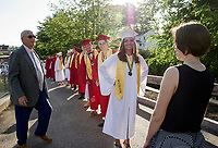 Delia Cormier, Nemanja Boskovic and Drew Muzzey pause outside of Jim Fitzgerald Field before they lead the processional for their class of 2018 at Laconia High School on Friday evening.  (Karen Bobotas/for the Laconia Daily Sun)