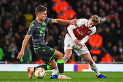 Arsenal Forward Emile Smith-Rowe (55) and Sporting Lisbon Midfielder Miguel Luis battle for the ball during the Europa League group stage match between Arsenal and Sporting Lisbon at the Emirates Stadium, London, England on 8 November 2018.