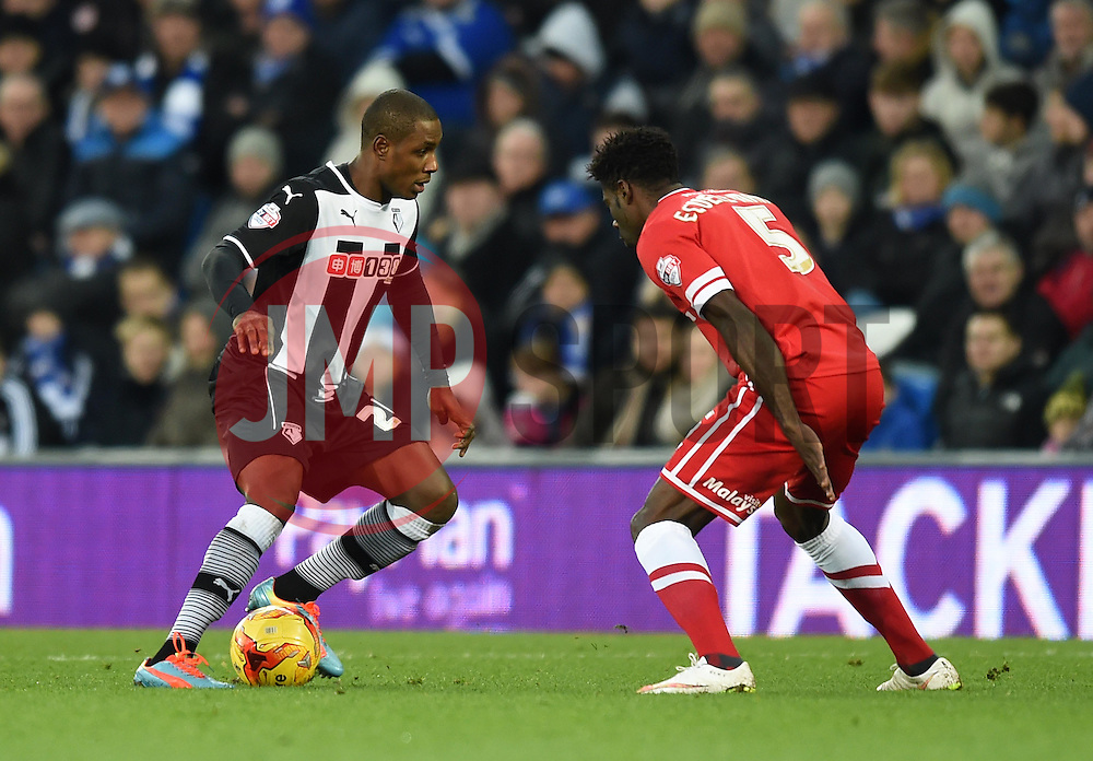 Watford's Odion Ighalo goes head to head with Cardiff City's Bruno Ecuele Manga - Photo mandatory by-line: Paul Knight/JMP - Mobile: 07966 386802 - 28/12/2014 - SPORT - Football - Cardiff - Cardiff City Stadium - Cardiff City v Watford - Sky Bet Championship