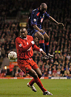 Photo. Jed Wee.Digitalsport<br /> Liverpool v Portsmouth, FA Barclaycard Premiership, Anfield, Liverpool. 17/03/2004.<br /> Portsmouth's Lomana Lua Lua (R) gets the better of Liverpool's Emile Heskey.