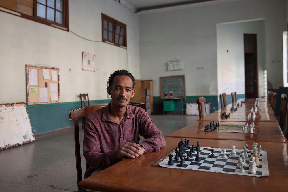 Chess teacher Yoan Céspedes Gutiérrez, posing at the mythical Casablanca Club in Havana, in honor to Cuban 6-time chess world champion Jose Raul Casablanca.
