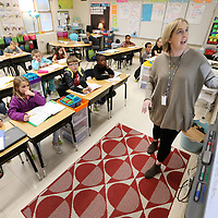 Kristy Cornelius, a third grade teacher at Nettleton Primary School, uses her Smart Board as she teaches the morning reading lesson with her students on Tuesday morning.