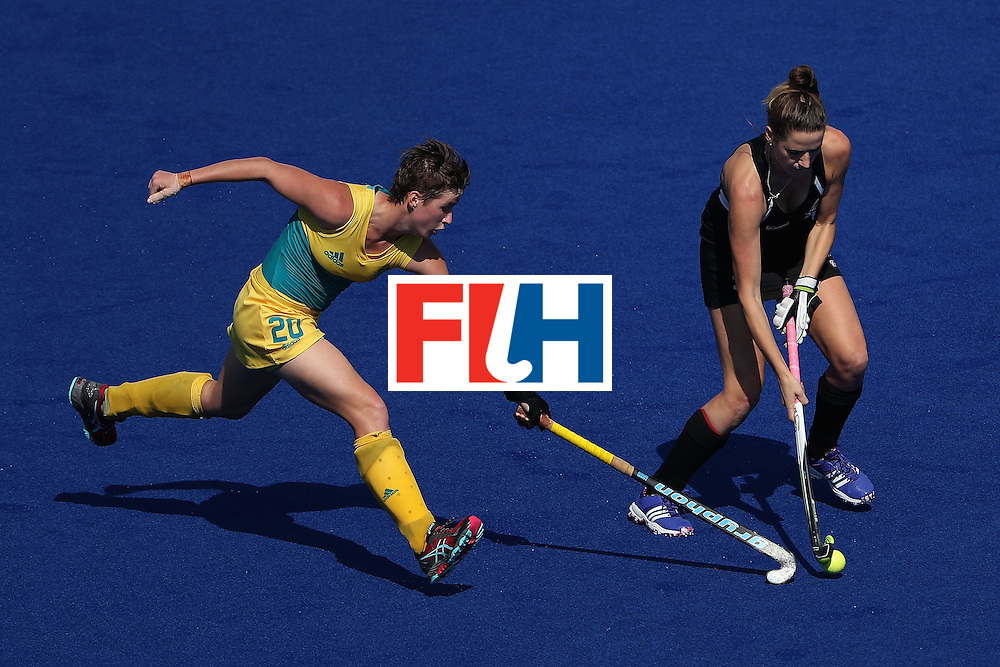 RIO DE JANEIRO, BRAZIL - AUGUST 15:  Pippa Hayward #26 of New Zealand attempts to move the ball past Kathryn Slattery #20 of Australia during the first half of the quarter final hockey game on Day 10 of the Rio 2016 Olympic Games at the Olympic Hockey Centre on August 15, 2016 in Rio de Janeiro, Brazil.  (Photo by Christian Petersen/Getty Images)