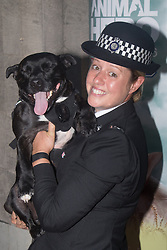 Grosvenor House Hotel, London, September 7th 2016. Celebrities attend the RSPCA's annual awards ceremony recognising the country's bravest animals and the individuals committed to improving their lives. PICTURED: A police officer cuddles her dog.