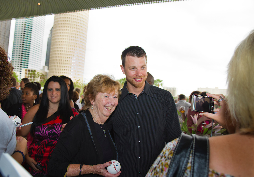 TP_340310_FREE_RAYSRUNWAY_..Caption:(Wednesday 06/29/2011 Tampa)Millie Diaz has her photo taken with Ben Zobrist after getting an autograph. Members of the Tampa Bay Rays and their wives walk the runway escorting children with life-threatening illnesses during the annual Rays on the Runway fashion event at the Tampa Museum of Art on Wednesday, June 29, to benefit the Children's Dream Fund. The show featured fashions by Saks Fifth Avenue. ..Summary:Tampa Bay Rays and their wives walk the runway escorting children with life-threatening illnesses during the annual Rays on the Runway fashion event at the Tampa Museum of Art...Photo by James Branaman