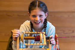 Spinning Workshop during the Scotland-wide World Heritage Day festivities. Six unique events, coordinated by Dig It! 2017, celebrated Scotland's six World Heritage Sites as part of the 2017 Year of History, Heritage and Archaeology. <br /> <br /> Pictured: Olivia Doherty (9) from Perth taking part in a Spinning Workshop