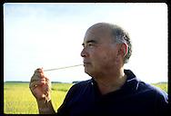Erico Ribeiro, world's largest rice grower, chews straw of grass on Rio Grande do Sul farm. Brazil