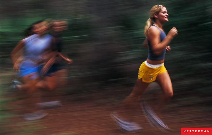 Girls running on trails.