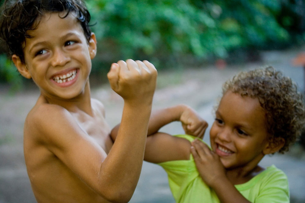 Boys show off their muscles for the camera in Barra Grande, Bahia, Brazil