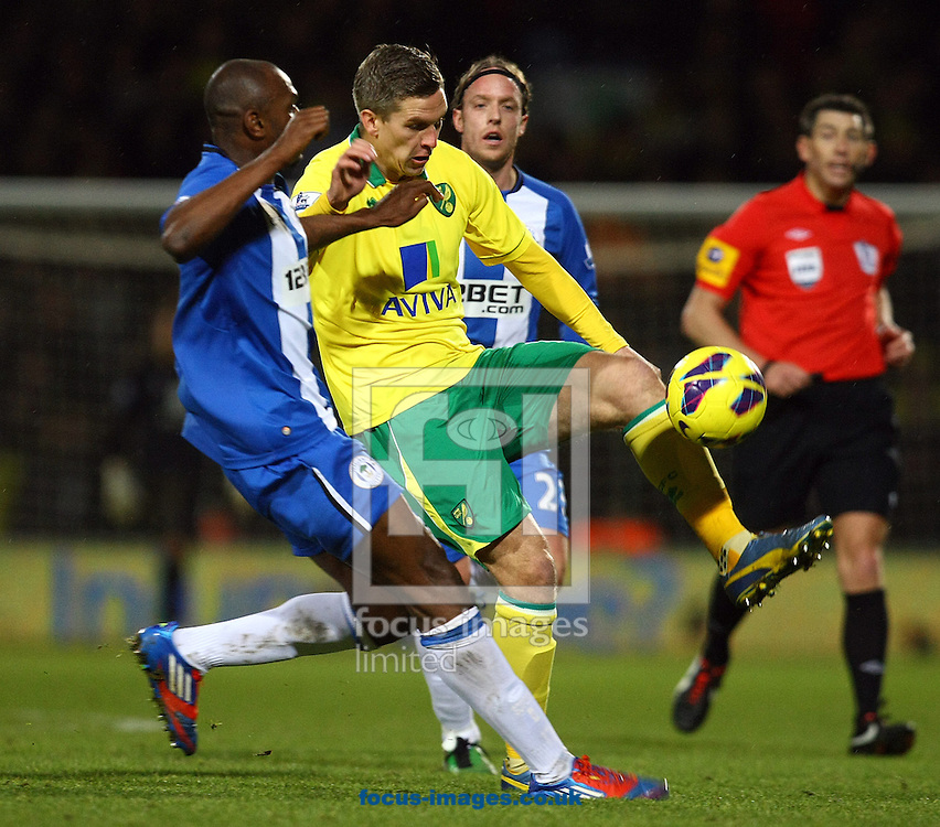 Picture by Paul Chesterton/Focus Images Ltd +44 7904 640267.15/12/2012.Emmerson Boyce of Wigan and Steve Morison of Norwich in action during the Barclays Premier League match at Carrow Road, Norwich.