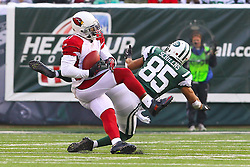 Dec 2, 2012; East Rutherford, NJ, USA; Arizona Cardinals cornerback Patrick Peterson (21) intercepts a pass from New York Jets quarterback Mark Sanchez (6) during the first half at MetLIfe Stadium.