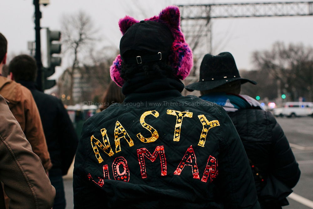 A woman wearing a Nasty Woman coat heads to the Women's March on Washington D.C., January 21, 2017