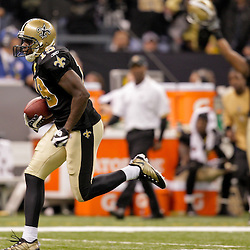 2009 November 30:  New Orleans Saints wide receiver Devery Henderson (19) runs after a catch for a first half touchdown during a 38-17 win by the New Orleans Saints over the New England Patriots at the Louisiana Superdome in New Orleans, Louisiana.