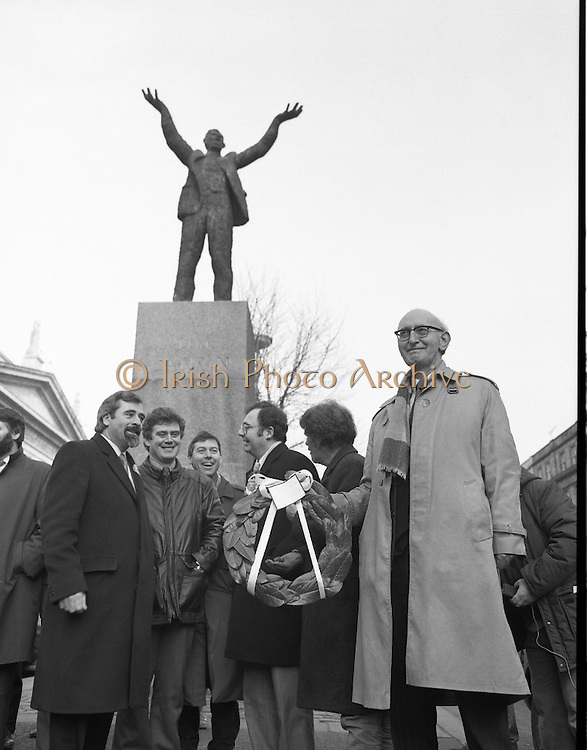 Workers Party Commemoration Of James Larkin.(R50)..1987..07.02.1987..02.07.1987..7th February 1987..A wreath laying ceremony was held today at the memorial for Trade Union leader,James Larkin. The ceremony was conducted the Workers' Party. Mr Tomás McGiolla, leader of the Workers'Party, laid the wreath at the memorial in O'Connell Street, Dublin. The ceremony was held to commomerate the 40th anniversary of the death of James Larkin...Image shows Mr McGiolla holding wreath at the monument in O'Connell Street. Include in the photograph are Clrs, E Byrne, Eamon Gilmore, Mike Jennings and Pat Rabitte.