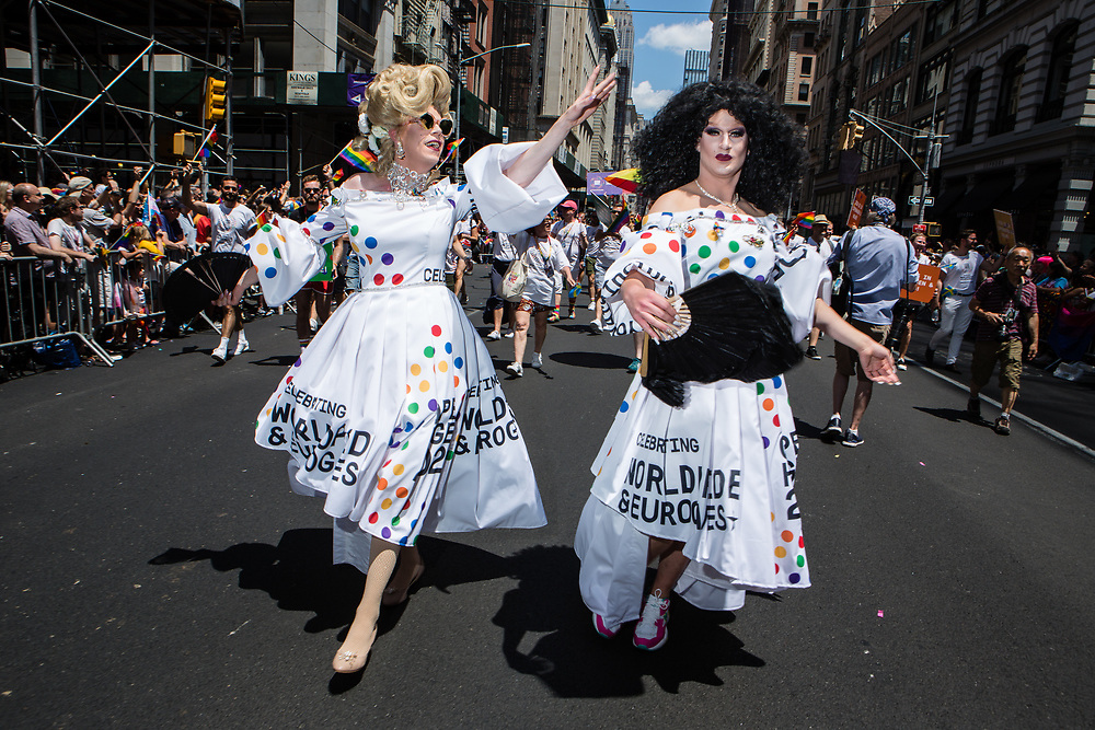 New York, NY - 30 June 2019. The New York City Heritage of Pride March filled Fifth Avenue for hours with participants from the LGBTQ community and it's supporters. Paticipants who appear to be cross-dressers in white dresses promoting World Pride and Eurogames.