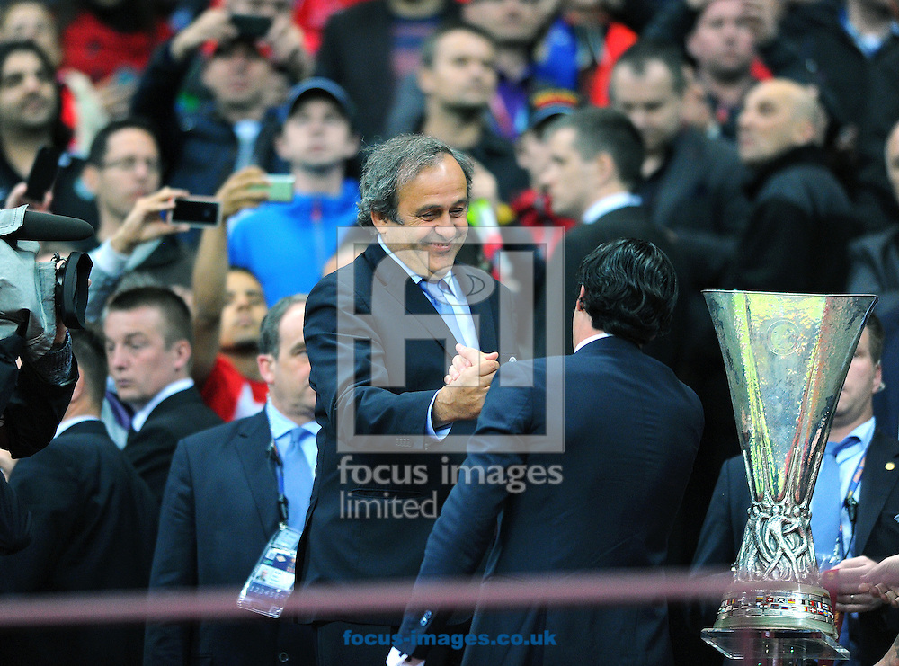 Sevilla manager Unai Emery (right) shake hands with Michel Platini, president of UEFA during the Europa League trophy presentation after the UEFA Europa League final at the National Stadium, Warsaw<br /> Picture by Greg Kwasnik/Focus Images Ltd +44 7902 021456<br /> 27/05/2015