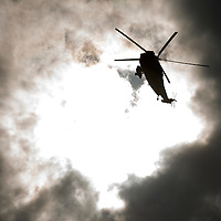 A Royal Navy Sea King Search and Rescue Helicopter flies through the sun at North Ledaig beach near Oban..<br /> Picture by Graeme Hart.<br /> Copyright Perthshire Picture Agency<br /> Tel: 01738 623350  Mobile: 07990 594431