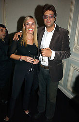 JAG BOLINA and CELIA SAMPSON at a party hosted by Ruinart Champagne at Claridges, Brook Street, London on 18th October 2006.<br />