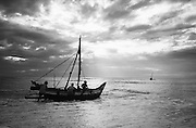 Launching a fishing boat at dawn at Tirukovil. East Coast of the country.