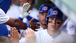 July 25, 2017 - Chicago, IL, USA - Chicago Cubs first baseman Anthony Rizzo is greeted in the dugout after scoring against the Chicago White Sox in the sixth inning on Tuesday, July 25, 2017, at Wrigley Field in Chicago. The Cubs won, 7-2. (Credit Image: © Brian Cassella/TNS via ZUMA Wire)