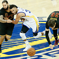 12 June 2017: Golden State Warriors guard Stephen Curry (30) vies for the ball with Cleveland Cavaliers guard Deron Williams (31) and Cleveland Cavaliers guard Kyle Korver (26) during the Golden State Warriors 129-120 victory over the Cleveland Cavaliers, in game 5 of the 2017 NBA Finals, at the Oracle Arena, Oakland, California, USA.