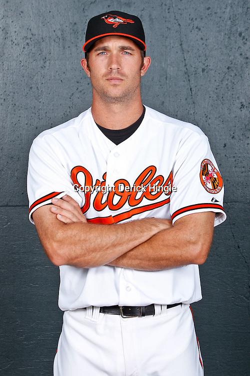 February 26, 2011; Sarasota, FL, USA; Baltimore Orioles shortstop J.J. Hardy (2) poses during photo day at Ed Smith Stadium.  Mandatory Credit: Derick E. Hingle