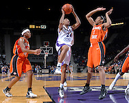 Kansas State forward Naytanda Smith (C) drives between Oklahoma State defenders Dominique Chism (R) and Danielle Green (L) for the score, during second half action at Bramlage Coliseum in Manhattan, Kansas, February 28, 2007.  Oklahoma State beat K-State 64-55.