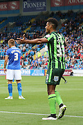 Lyle Taylor of AFC Wimbledon sets up Andy Barcham of AFC Wimbledon during the Sky Bet League 2 match between Carlisle United and AFC Wimbledon at Brunton Park, Carlisle, England on 22 August 2015. Photo by Stuart Butcher.