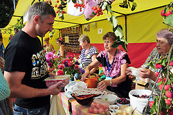 "Vying for the best berry pie at an end-of-summer agricultural fair in Uglich, Russia. As one of Russia's ""Golden Ring"" cities, Uglich is designated a town of significant cultural importance."