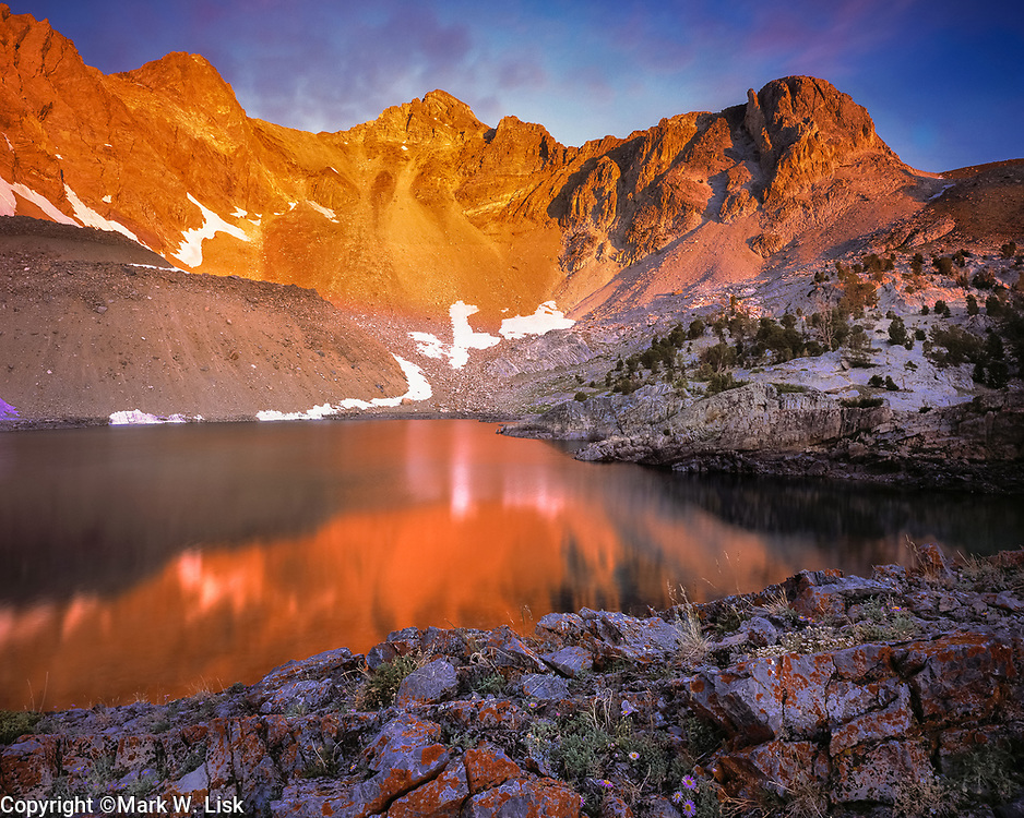 The sun rises and slowly melts the last of winter's snow into Pass Lake in the Lost River Range, Idaho