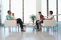 People sitting in modern waiting room