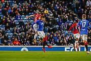 Matt Kilgallon of Hamilton Academical FC jumps with Kyle Lafferty of Rangers during the Ladbrokes Scottish Premiership match between Rangers and Hamilton Academical FC at Ibrox, Glasgow, Scotland on 16 December 2018.