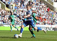 © Andrew Fosker / Richard Lane Photography 2010 -  Shane Long nails Reading's fifth goal of the game - Mark Little  is right Reading v Peterborough - Coca-Cola Championship - 17/04/2010 - Madejski Stadium - Reading - UK.