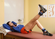 S.S. Seward girls' basketball player Sara Cannillo, who is recovering from surgery to repair the anterior cruciate ligament in her right knee, exercises her leg at Access Physical Therapy & Wellness in Goshen on Monday, Feb. 14, 2011.