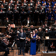 """November 21, 2013 - New York, NY :  Conductor Alan Gilbert, on podium at right, leads the New York Philharmonic, the New York Choral Artists, and the Brooklyn Youth Chorus, along with vocal soloists, tenor Dominic Armstrong (in tie standing at left), and soprano Kate Royal (standing at center in violet dress) in Bejamin Britten's """"Spring Symphony, Op. 44 (1948-49)"""" with the New York Philharmonic at Avery Fisher Hall at Lincoln Center on Thursday night. Armstrong made his NY Phil debut as a last-minute substitution for tenor Paul Appleby, who withdrew due to illness. CREDIT: Karsten Moran for The New York Times"""
