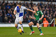 Bristol Rovers Defender, Tom Lockyer (4) tackles Scunthorpe United Forward, Paddy Madden (9) and leads to an own goal scored 1-1 during the EFL Sky Bet League 1 match between Bristol Rovers and Scunthorpe United at the Memorial Stadium, Bristol, England on 25 February 2017. Photo by Adam Rivers.