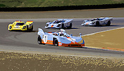 Image of Porsche 917s on track at Rennsport Reunion IV, Laguna Seca Raceway, Monterey, California, America west coast