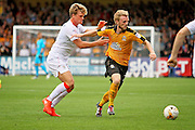Cambridge Utd defender Max Clark (20) shrugs off Luton Town midfielder Cameron McGeehan (8) during the EFL Sky Bet League 2 match between Cambridge United and Luton Town at the R Costings Abbey Stadium, Cambridge, England on 27 August 2016. Photo by Nigel Cole.