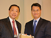 Dr. Leung presents Lamar HS teacher Liming Guo with the Outstanding Asian-Pacific American award and $500.