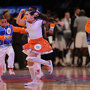 Young performers in action during a time out in a Golden State Warriors Vs New York Knicks game. NBA Basketball. Madison Square Garden, New York. USA.  Photo Tim Clayton