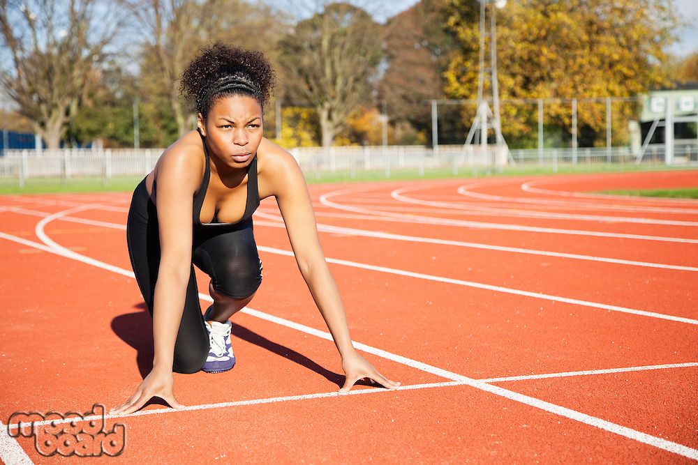 African American female runner at the starting line