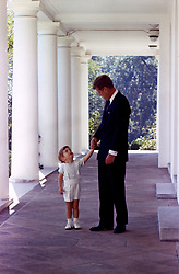 John F. Kennedy, the nation's 35th President, would have turned 100 years old on May 29, 2017. With the centennial anniversary of John F. Kennedy's birth, the former president's legacy is being celebrated across the nation. PICTURED: Oct. 10, 1963 - Washington, District of Columbia, U.S. - President JOHN F. KENNEDY holding hands with son JOHN F. KENNEDY JR. at the White House. (Credit Image: © John F. Kennedy Library/ZUMAPRESS.com)